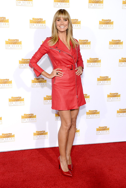 . Host Heidi Klum attends NBC and Time Inc. celebrate the 50th anniversary of the Sports Illustrated Swimsuit Issue at Dolby Theatre on January 14, 2014 in Hollywood, California.  (Photo by Dimitrios Kambouris/Getty Images)
