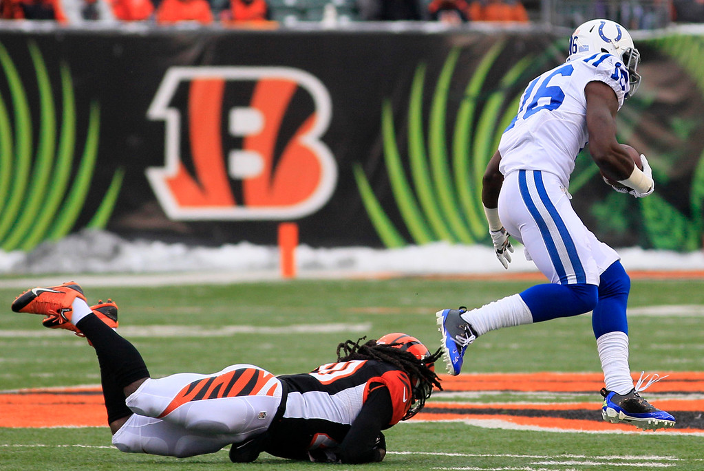 . Indianapolis Colts wide receiver Da\'Rick Rogers (16) runs past Cincinnati Bengals free safety Reggie Nelson on his way to a 69-yard touchdown after catching a pass in the second half of an NFL football game, Sunday, Dec. 8, 2013, in Cincinnati. (AP Photo/Tom Uhlman)