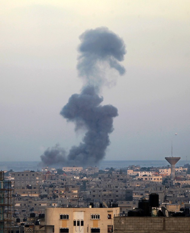 . Smoke billows from buildings following an Israeli air strike in Rafah, in the southern Gaza Strip, on July 31, 2014. Israel vowed to keep its troops in Gaza until they finish destroying a network of cross-border tunnels, despite sharp UN and US criticism over the Palestinian death toll. AFP PHOTO/ SAID KHATIB/AFP/Getty Images