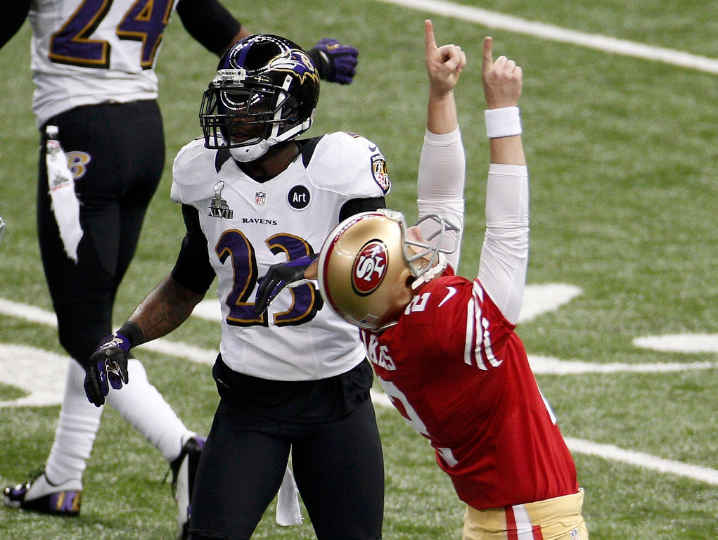 . San Francisco 49ers kicker David Akers (2) celebrates after kicking a field goal as Baltimore Ravens defensive back Chykie Brown (23) looks on in the first quarter of the NFL Super Bowl XLVII football game in New Orleans, Louisiana, February 3, 2013 REUTERS/Jonathan Bachman