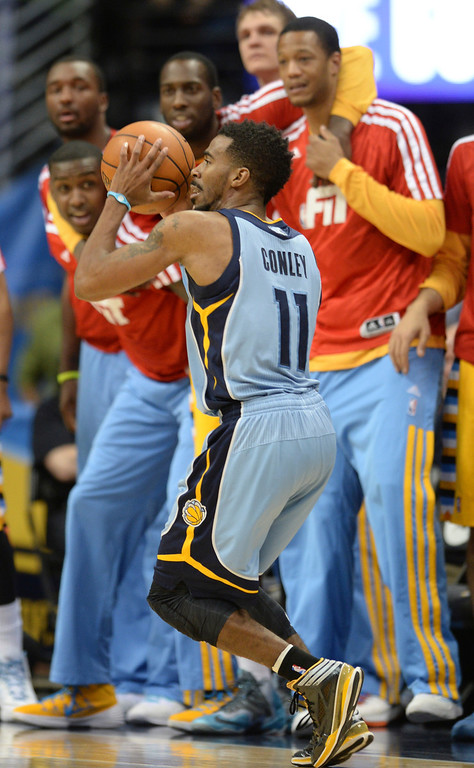 . DENVER, CO. - JANUARY 03:  The Nuggets\' bench eyed Memphis guard Mike Conley as he looked for a shot late in the fourth quarter. The Denver Nuggets broke an eight-game losing streak with a 111-108 win over the Memphis Grizzlies at the Pepsi Center Friday night, January 3, 2014. Photo By Karl Gehring/The Denver Post