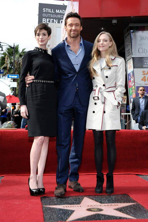 . From left to right, actress Anne Hathaway, actor Hugh Jackman, and actress Amanda Seyfried attend Jackman\'s star ceremony at the Hollywood Walk of Fame on Thursday, Dec. 13, 2012, in Los Angeles. (Photo by Dan Steinberg/Invision/AP)