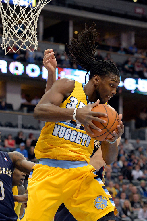 . Denver Nuggets forward Kenneth Faried (35) hauls down a rebound against the New Orleans Pelicans April 2, 2014 at the Pepsi Center in Denver. (Photo by John Leyba/The Denver Post)