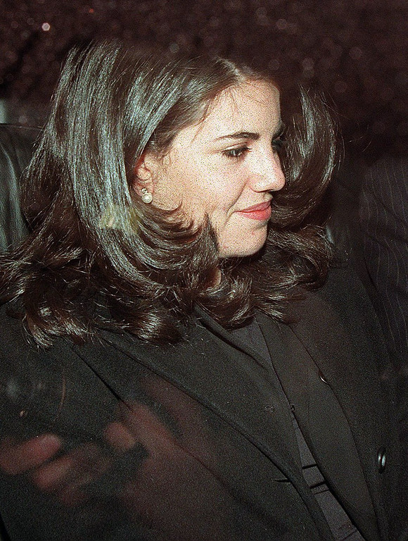 . This January 29, 1998 file photo shows Monica Lewinsky as she sits in the back of a car in Washington DC.  AFP PHOTO   Luke FRAZZA/AFP/Getty Images