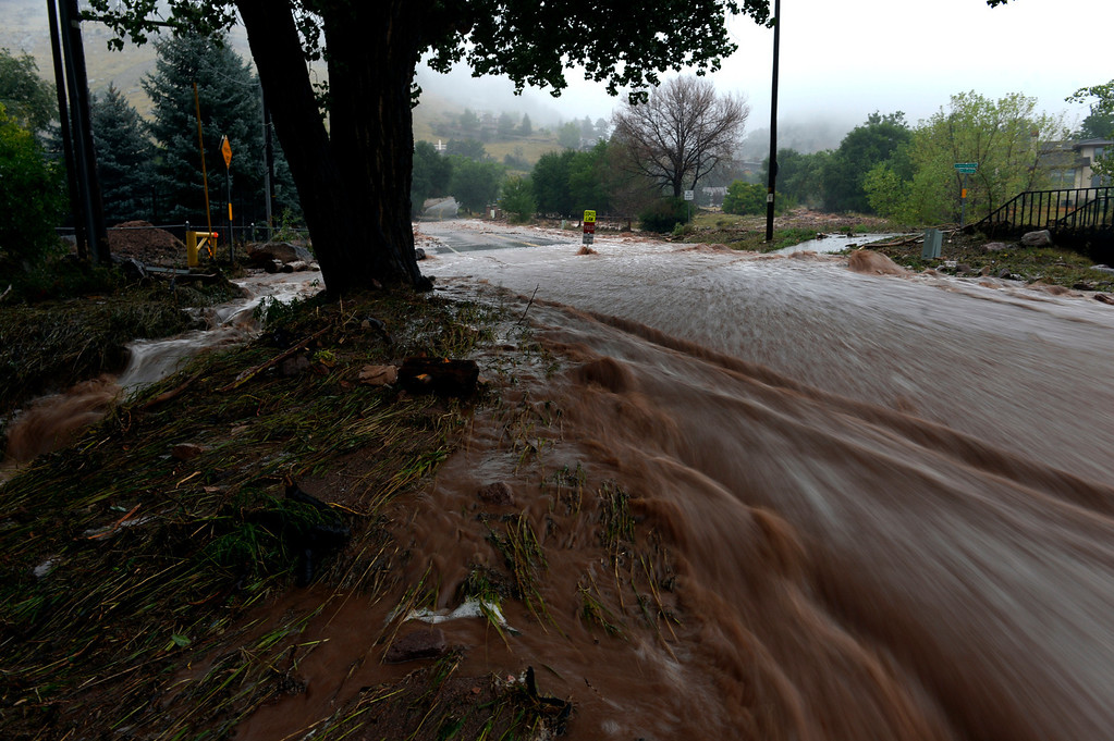 . BOULDER, CO. - SEPTEMBER12:  Water rushes down Linden Ave in Boulder CO September 12, 2013. Record-breaking rain turned normally quiet creeks into raging, brown torrents that swept through Boulder on Thursday, flooding homes, swamping cars and closing roads and schools. (Photo By Craig F. Walker / The Denver Post)