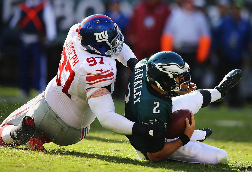 . Linval Joseph #97 of the New York Giants sacks  Matt Barkley #2 of the Philadelphia Eagles during their game at Lincoln Financial Field on October 27, 2013 in Philadelphia, Pennsylvania.  (Photo by Al Bello/Getty Images)