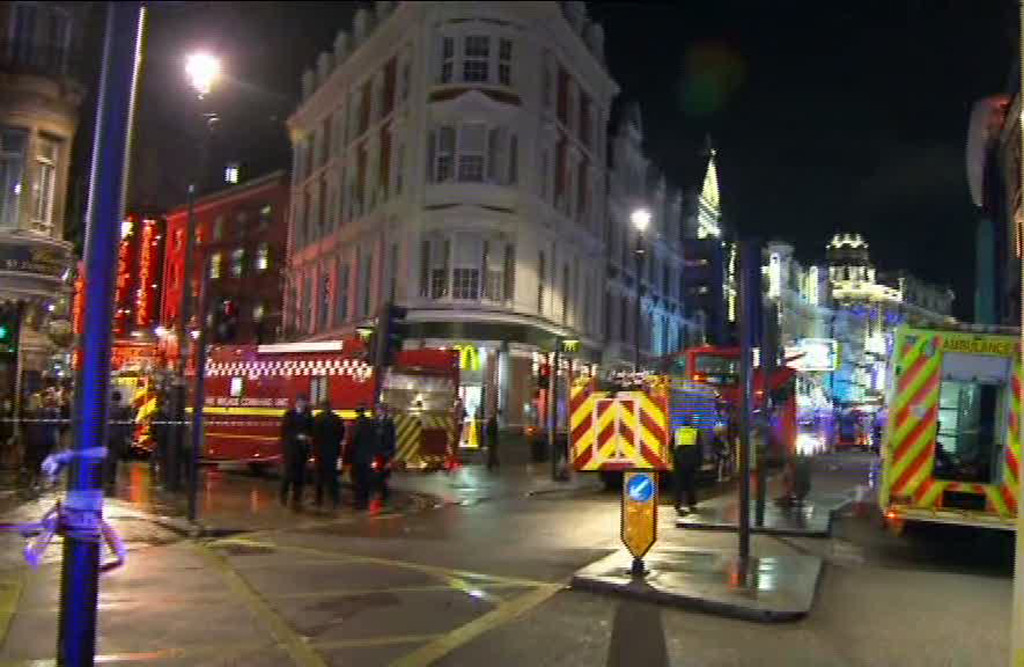 ". This image taken from television shows emergency services attending an incident at the Apollo Theatre, illuminated at rear right, in London\'s Shaftesbury Avenue, Thursday evening, Dec. 19, 2013, during a performance at the height of the Christmas season, with police saying there were ""a number\"" of casualties. It wasn\'t immediately clear if the roof, ceiling or balcony collapsed during a performance. Police said they \""are aware of a number of casualties,\"" but had no further details. (AP Photo/Sky News)  UNITED KINGDOM OUT,  TV OUT"