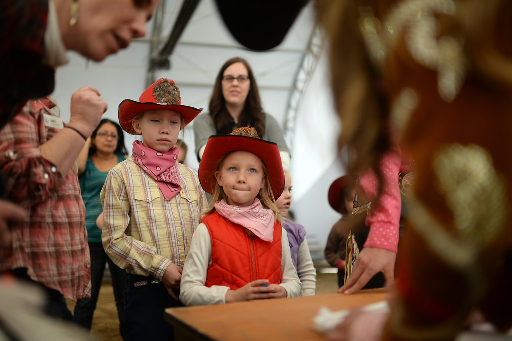 . DENVER, CO. JANUARY 25: Leiana Butchart, 8, and her sister Kira, 6, register for the stick horse rodeo at Ames Activity Pavilion at the National Western Stock Show in Denver, Colorado January 25, 2014. Twenty-eight children competed in the event. (Photo by Hyoung Chang/The Denver Post)