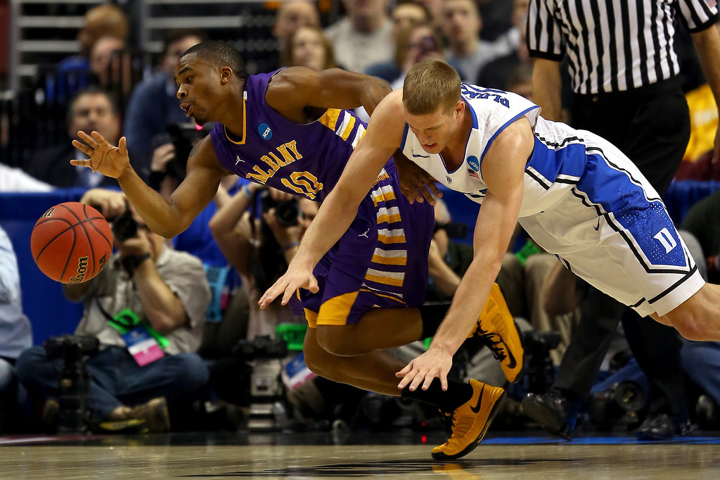 . Mike Black #10 of the Albany Great Danes and Mason Plumlee #5 of the Duke Blue Devils go after a loose ball in the first half during the second round of the 2013 NCAA Men\'s Basketball Tournament on March 22, 2013 at Wells Fargo Center in Philadelphia, Pennsylvania.  (Photo by Elsa/Getty Images)