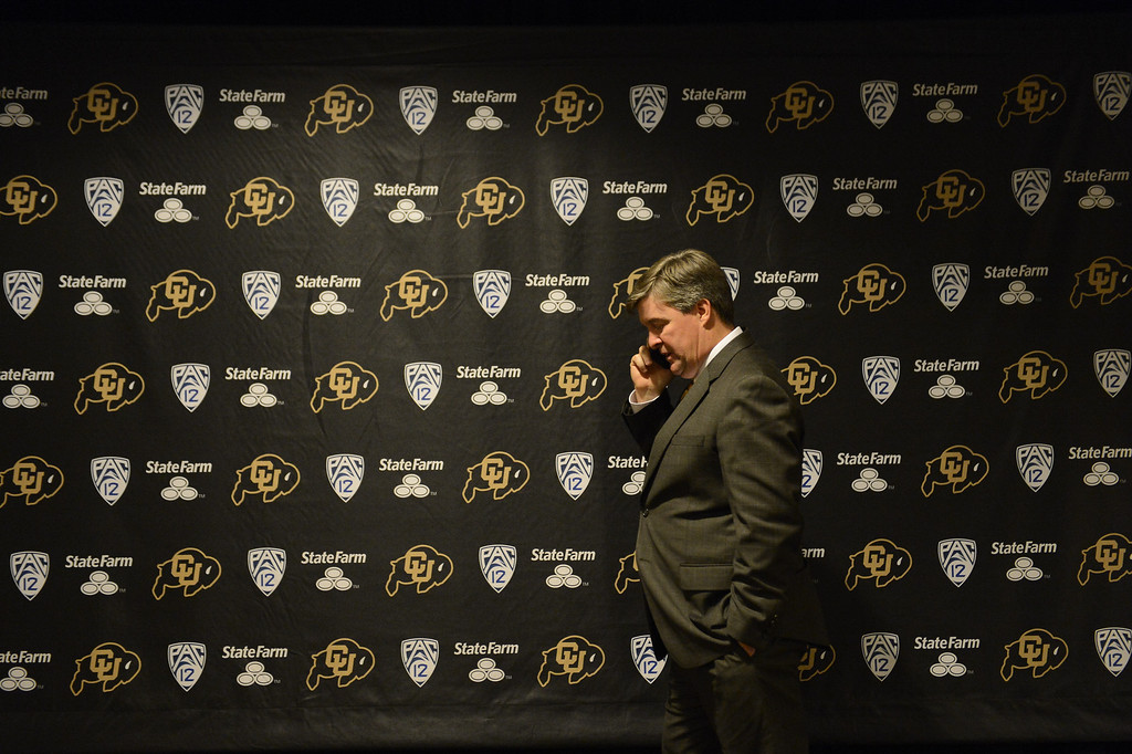 . The University of Colorado at Boulder introduced Mike MacIntyre as its new head football coach at a press conference Monday, December 10, 2012  at the Byron White Club Room at Folsom Field. Coach MacIntyre does a phone interview after teh announcement. MacIntyre will be the 25th full-time head football coach in the CU history as he comes from San Jose State. John Leyba, The Denver Post