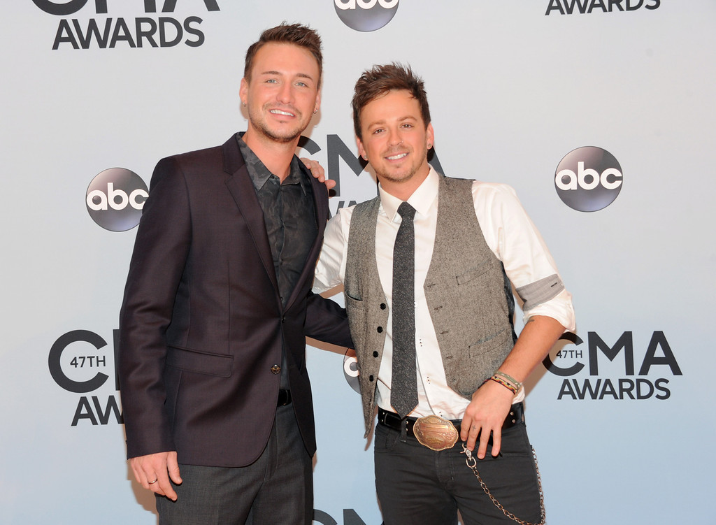. Eric Gunderson, left, and Stephen Barker Liles, of Love and Theft arrive at the 47th annual CMA Awards at Bridgestone Arena on Wednesday, Nov. 6, 2013, in Nashville, Tenn. (Photo by Evan Agostini/Invision/AP)