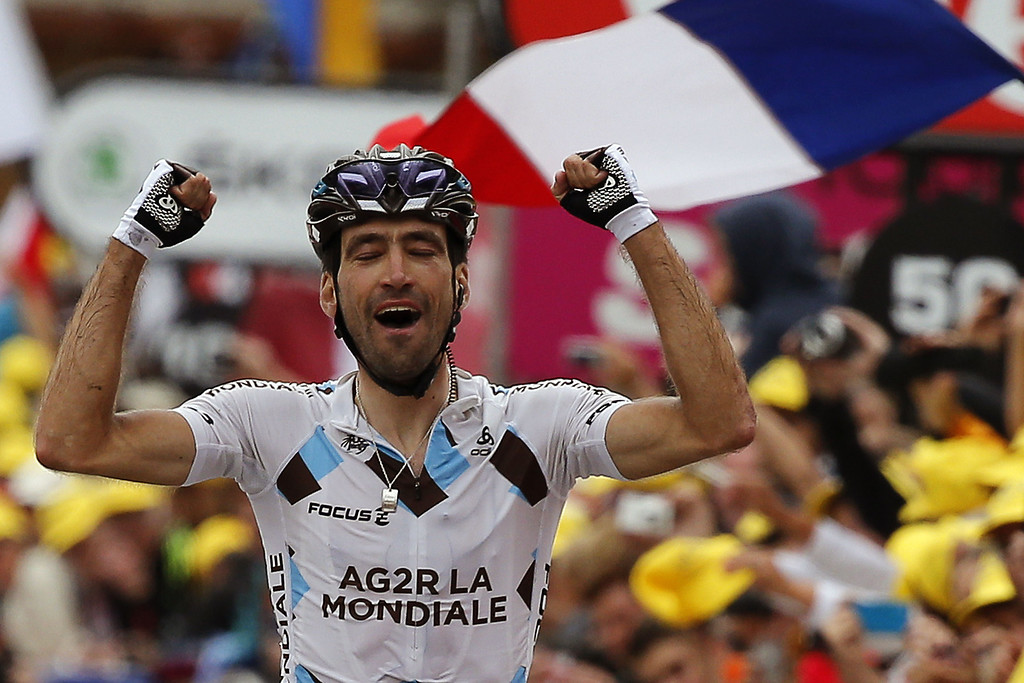 . France\'s Christophe Riblon celebrates as he crosses the finish line at the end of the 172.5 km eighteenth stage of the 100th edition of the Tour de France cycling race on July 18, 2013 between Gap and Alpe-d\'Huez, French Alps.  JEFF PACHOUD/AFP/Getty Images