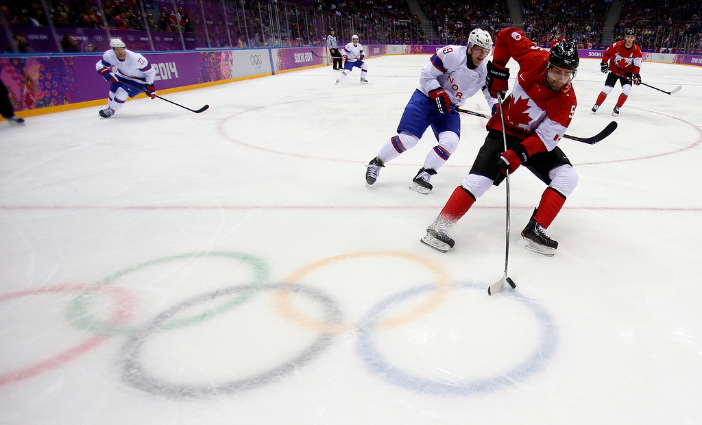 . Canada\'s Dan Hamhuis (5) controls the puck against Norway\'s Per-Age Skroder (19) in the second period for their preliminary round at the Bolshoy Ice Dome for the 2014 Winter Olympics in Sochi, Russia on Thursday, Feb. 13, 2014.  (Nhat V. Meyer/Bay Area News Group)