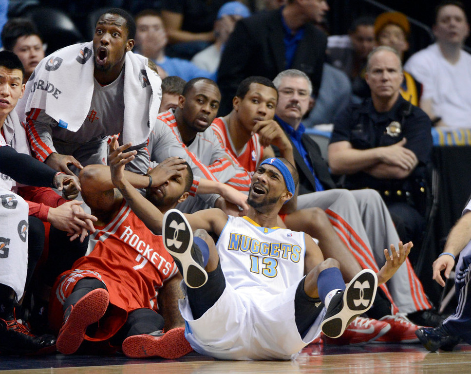 . DENVER, CO. - JANUARY 30: Denver Nuggets small forward Corey Brewer (13) looks to the referee for the foul after Houston Rockets power forward Marcus Morris (2) ran in to him attempting a three pointer during the third quarter January 30, 2013 at Pepsi Center. Marcus Morris was called for the foul.  The Denver Nuggets take on the Houston Rockets in NBA action. (Photo By John Leyba/The Denver Post)