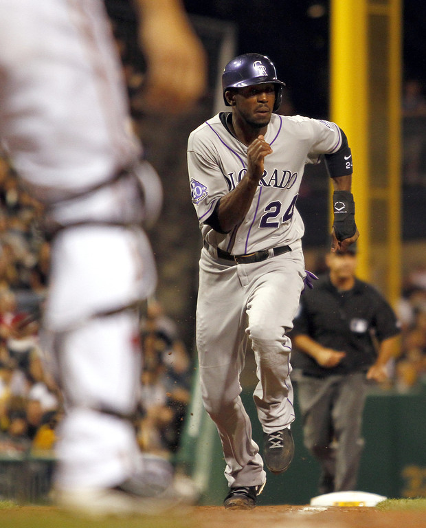 . PITTSBURGH, PA - AUGUST 03:  Dexter Fowler #24 of the Colorado Rockies scores on an infield single in the eighth inning against the Pittsburgh Pirates during the game on August 3, 2013 at PNC Park in Pittsburgh, Pennsylvania.  (Photo by Justin K. Aller/Getty Images)