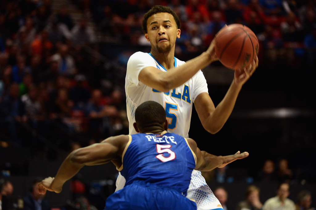 . Kyle Anderson #5 of the UCLA Bruins looks to pass against Tim Peete #5 of the Tulsa Golden Hurricane during the second round of the 2014 NCAA Men\'s Basketball Tournament at Viejas Arena on March 21, 2014 in San Diego, California.  (Photo by Donald Miralle/Getty Images)