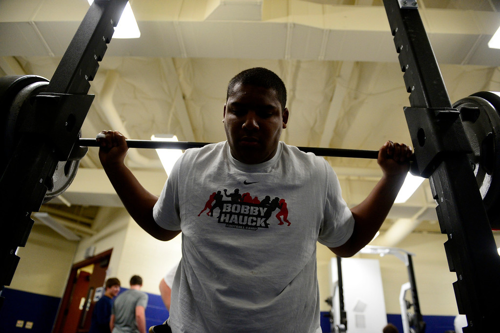 . Valor Christian starting right tackle Isaiah Holland prepares to squat during a lift.  (Photo by AAron Ontiveroz/The Denver Post)