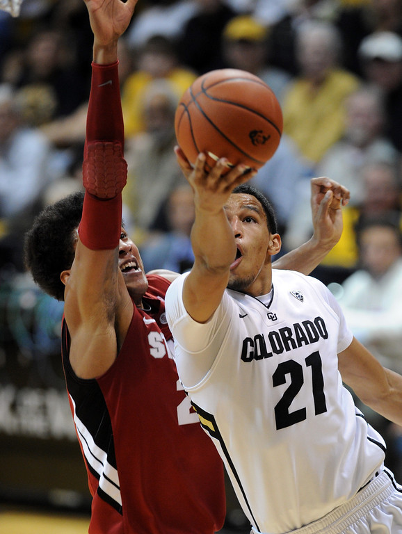 . Andre Roberson of Colorado goes o the basket past Josh Huestis of Stanford during the second half of the January 24th, 2013 game in Boulder. For more photos of the game, go to www.dailycamera.com. Cliff Grassmick / January 24, 2013