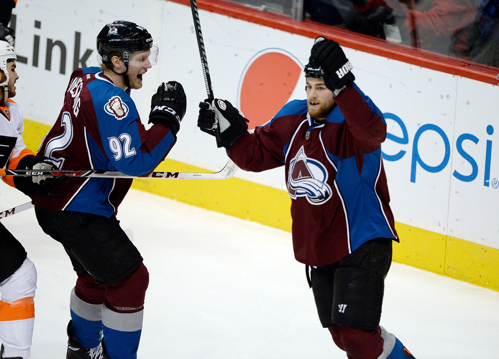 . Colorado Avalanche center Ryan O\'Reilly (90) celebrates his goal with Colorado Avalanche left wing Gabriel Landeskog (92)  during the second period  against the Philadelphia Flyers January 2, 2014 at Pepsi Center. (Photo by John Leyba/The Denver Post)