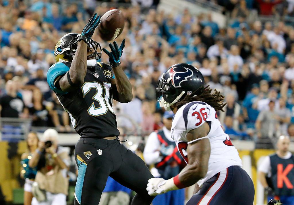 . Jordan Todman #30 of the Jacksonville Jaguars makes a reception for a touchdown against  D.J. Swearinger #36 of the Houston Texans during the game at EverBank Field on December 5, 2013 in Jacksonville, Florida.  (Photo by Sam Greenwood/Getty Images)