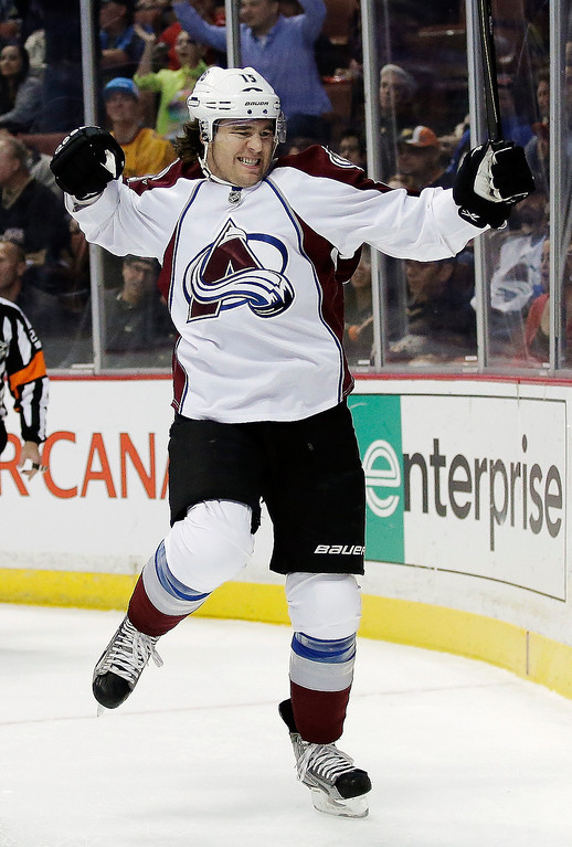 . Colorado Avalanche right wing P.A. Parenteau celebrates his goal against the Anaheim Ducks during the first period of an NHL hockey game in Anaheim, Calif., Sunday, Feb. 24, 2013. (AP Photo/Chris Carlson)