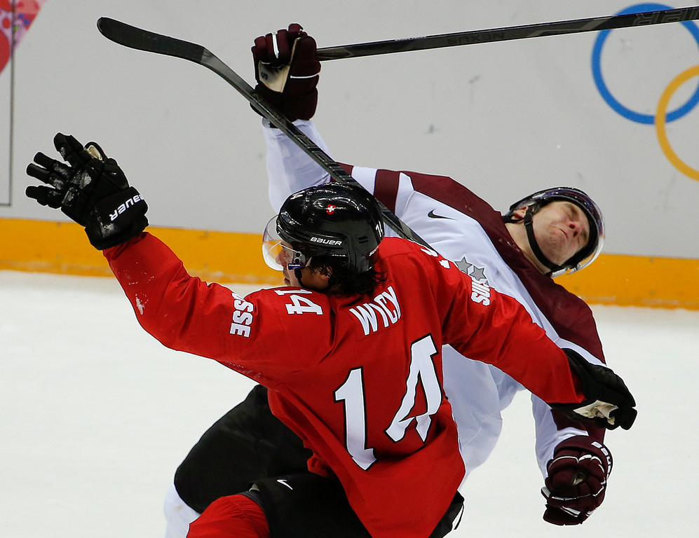 . period of a men\'s ice hockey game at the 2014 Winter Olympics, Tuesday, Feb. 18, 2014, in Sochi, Russia. (AP Photo/Julio Cortez)
