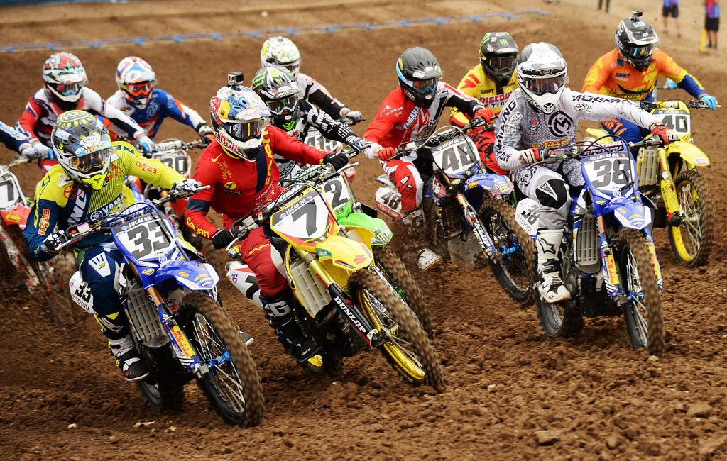 . James Stewart Jr. (7) and 450 Class racers starts 450 Moto #1 race in the mile high altitude of Thunder Valley MX Park for the third round of the Lucas Oil Pro Motocross Championship. Lakewood, Colorado. June 07. 2014. Stewart finished as 1st place. (Photo by Hyoung Chang/The Denver Post)