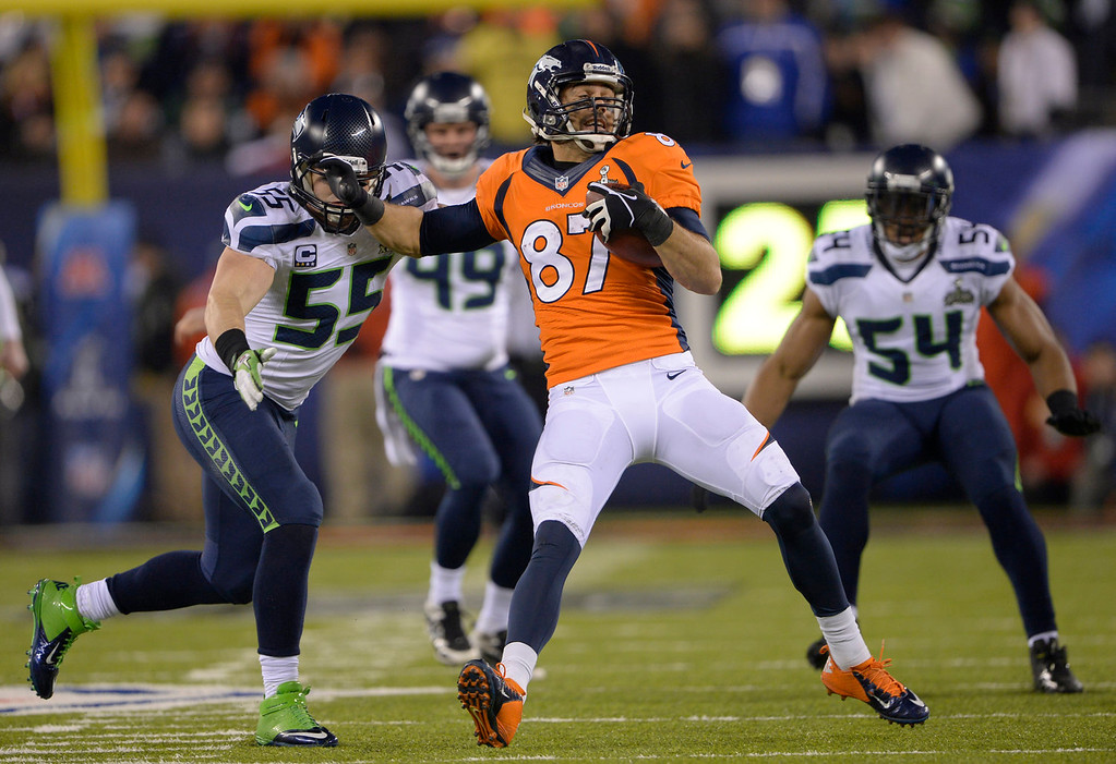 . Denver Broncos wide receiver Eric Decker (87) fights of a tackle during the third quarter. The Denver Broncos vs the Seattle Seahawks in Super Bowl XLVIII at MetLife Stadium in East Rutherford, New Jersey Sunday, February 2, 2014. (Photo by Joe Amon/The Denver Post)