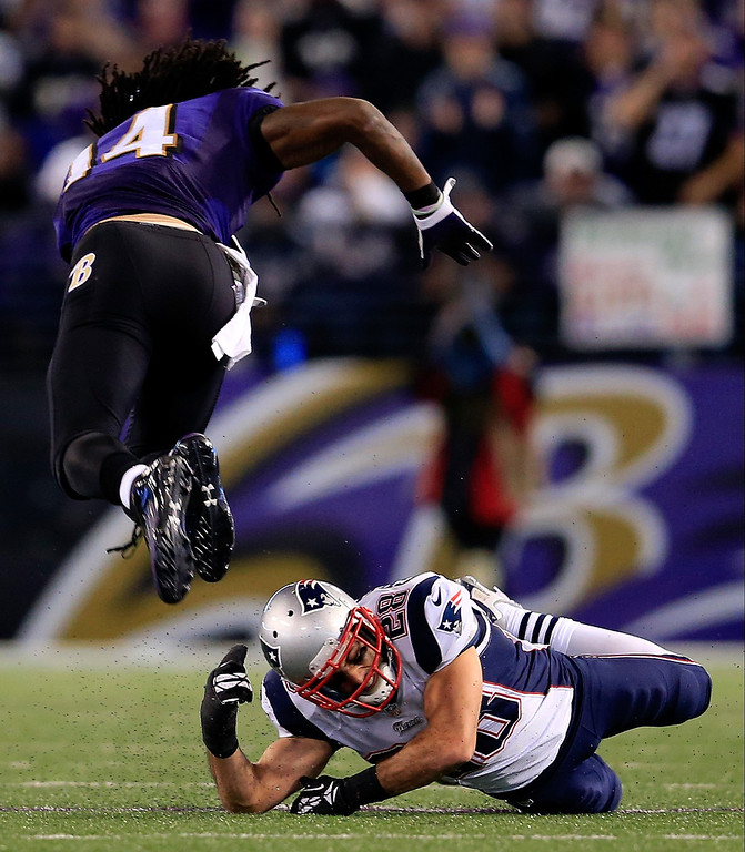 . Wide receiver Marlon Brown #14 of the Baltimore Ravens is tackled by strong safety Steve Gregory #28 of the New England Patriots during the second half at M&T Bank Stadium on December 22, 2013 in Baltimore, Maryland.  (Photo by Rob Carr/Getty Images)