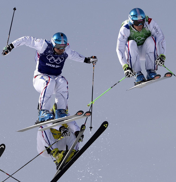 . France\'s Arnaud Bovolenta (blue) France\'s Jean Frederic Chapuis (green) and France\'s Jonathan Midol (rear) race in the Men\'s Freestyle Skiing Ski Cross Final at the Rosa Khutor Extreme Park during the Sochi Winter Olympics on February 20, 2014. AFP PHOTO / FRANCK  FIFE/AFP/Getty Images