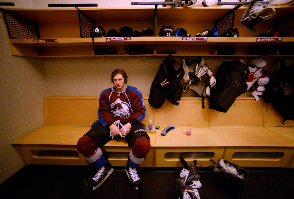 . Colorado Avalanche center Nathan MacKinnon (29) sits at his locker after talking with the media after being defeated by the Minnesota Wild 5 to 4 in overtime.   (Photo by John Leyba/The Denver Post)