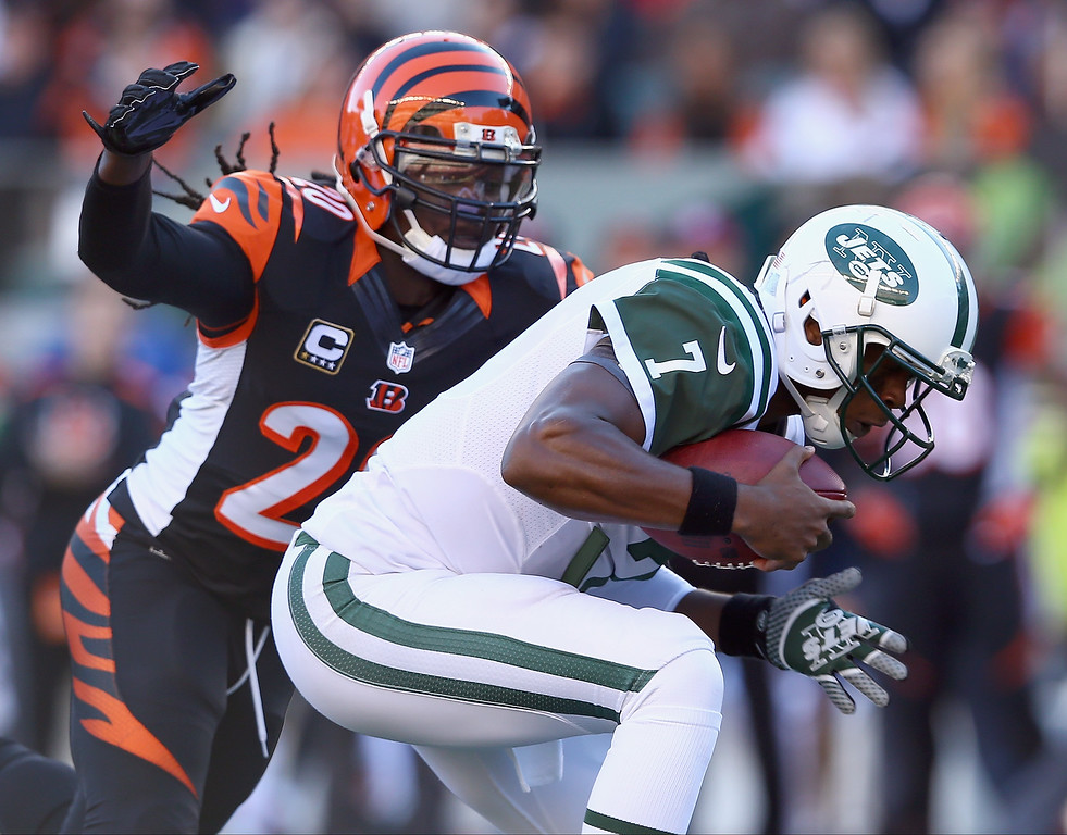 . Geno Smith #7 of the New York Jetsis sacked by Reggie Nelson #20 of the Cincinnati Bengals during the game at Paul Brown Stadium on October 27, 2013 in Cincinnati, Ohio.  (Photo by Andy Lyons/Getty Images)