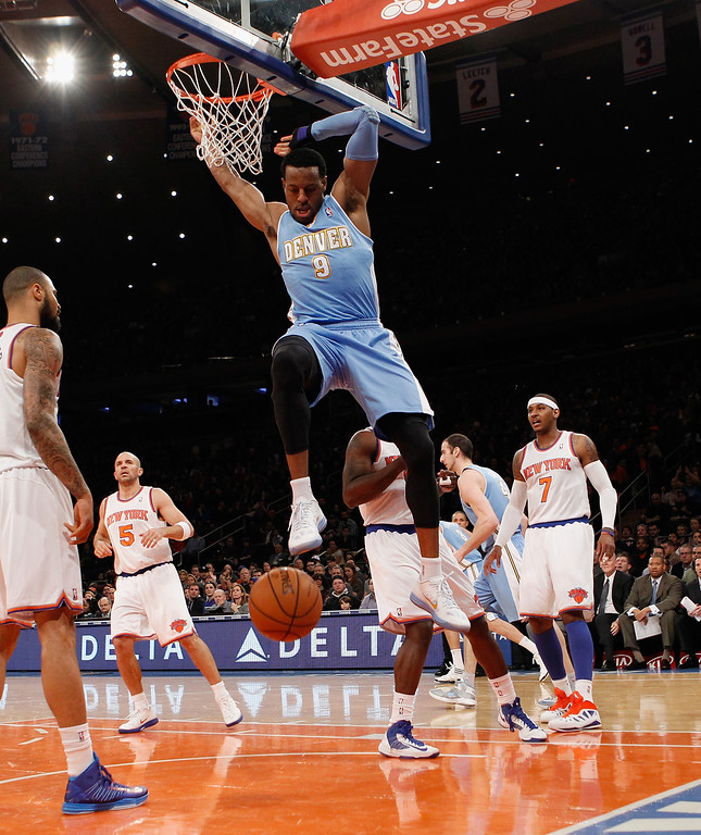 . NEW YORK, NY - DECEMBER 09: Andre Iguodala #9 of the Denver Nuggets scores a basket in the first quarter against the New York Knicks at Madison Square Garden on December 9, 2012 in New York City.   (Photo by Bruce Bennett/Getty Images)