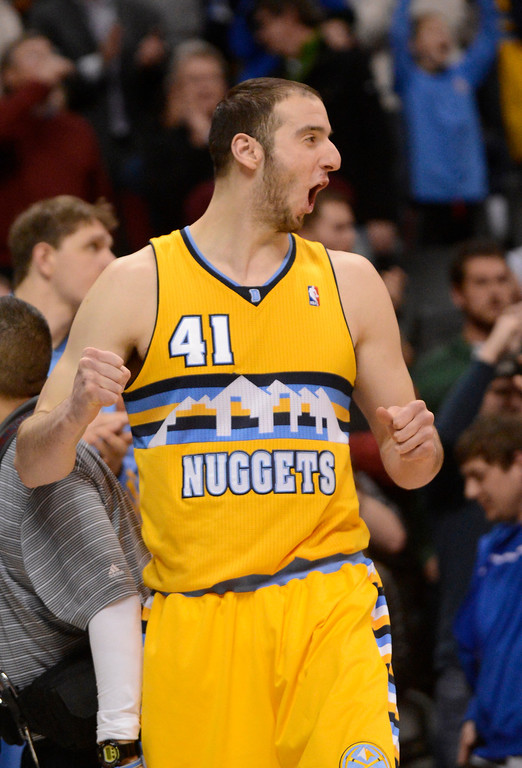 . Denver Nuggets center Kosta Koufos (41) celebrates a win over the as the Trail Blazers 115-11 Tuesday, January 15, 2013 at Pepsi Center. John Leyba, The Denver Post
