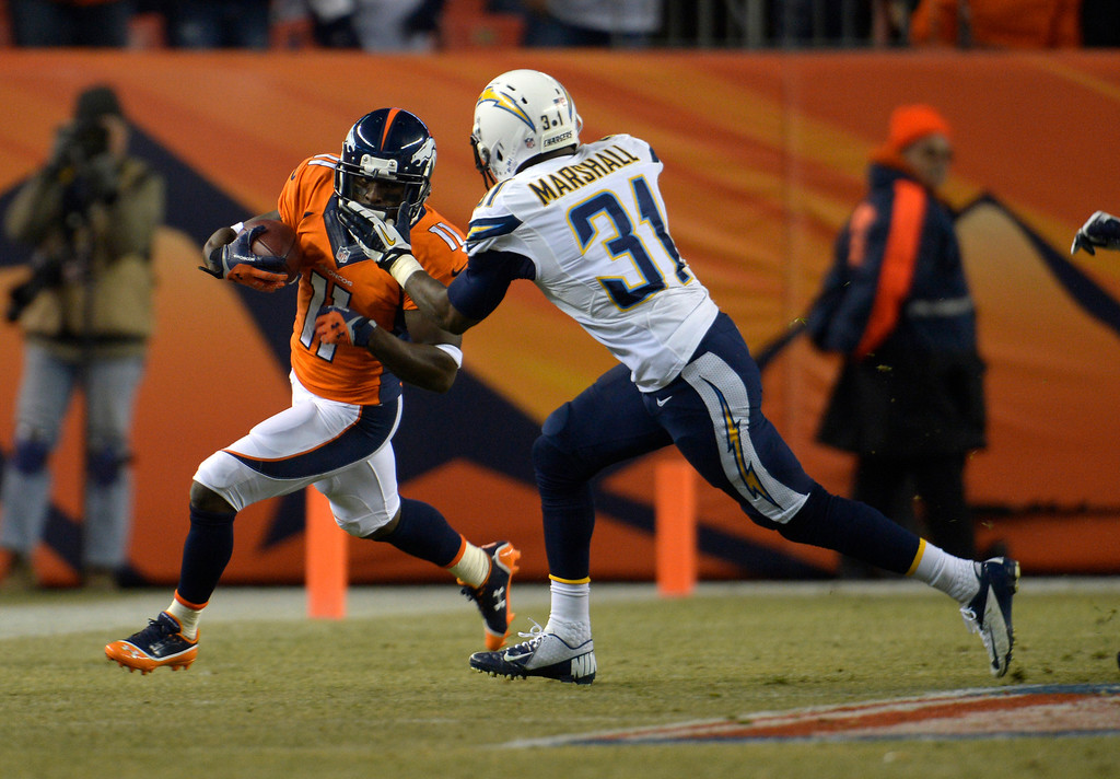. Denver Broncos wide receiver Trindon Holliday (11) runs the ball back against San Diego Chargers cornerback Richard Marshall (31) during the second quarter. The Denver Broncos vs. the San Diego Chargers at Sports Authority Field at Mile High in Denver on December 12, 2013. (Photo by Joe Amon/The Denver Post)