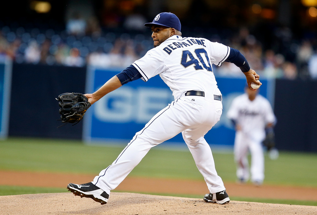 . San Diego Padres starting pitcher Odrisamer Despaigne throws against the Colorado Rockies in the first inning of a baseball game Tuesday, Aug. 12, 2014, in San Diego. (AP Photo/Lenny Ignelzi)