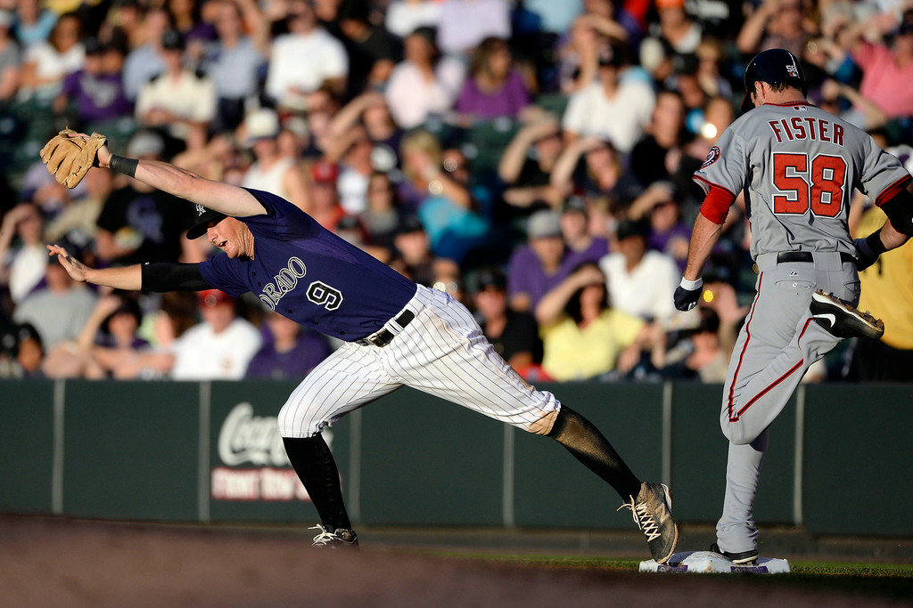 . Colorado Rockies second baseman D.J. LeMahieu cannot make the stretch at first to get Doug Fister (58) of the Washington Nationals out at Coors Field. Major League Baseball action between the Colorado Rockies and the Washington Nationals on Monday, July 21, 2014. (Photo by AAron Ontiveroz/The Denver Post)