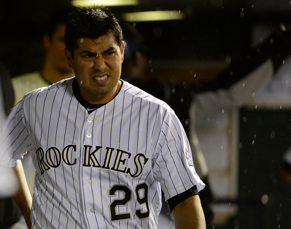 . DENVER, CO. - MAY 07: Jorge De La Rosa (29) of the Colorado Rockies heads out from the dugout as the rain begins to fall in the fourth inning May 7, 2013 at Coors Field. (Photo By John Leyba/The Denver Post)