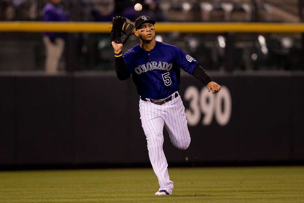 . Left fielder Carlos Gonzalez #5 of the Colorado Rockies makes a catch on the run for the final out of the game as the Rockies defeated the Chicago White Sox 8-1 at Coors Field on April 7, 2014 in Denver, Colorado. (Photo by Justin Edmonds/Getty Images)