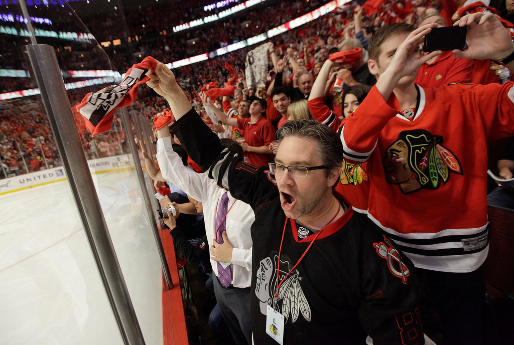 . Chicago Blackhawk fans celebrate a second period goal against the Boston Bruins during Game 5 of the NHL hockey Stanley Cup Finals, Saturday, June 22, 2013, in Chicago. (AP Photo/Nam Y. Huh)