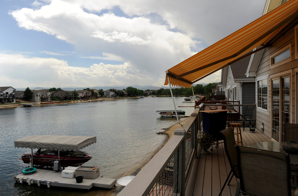 . The lakeside view at Lewis\' condo inspired many of the art selections that Frances Owens and Barb Tobias made at ARC Thrift stores. (Photo By Cyrus McCrimmon/The Denver Post)