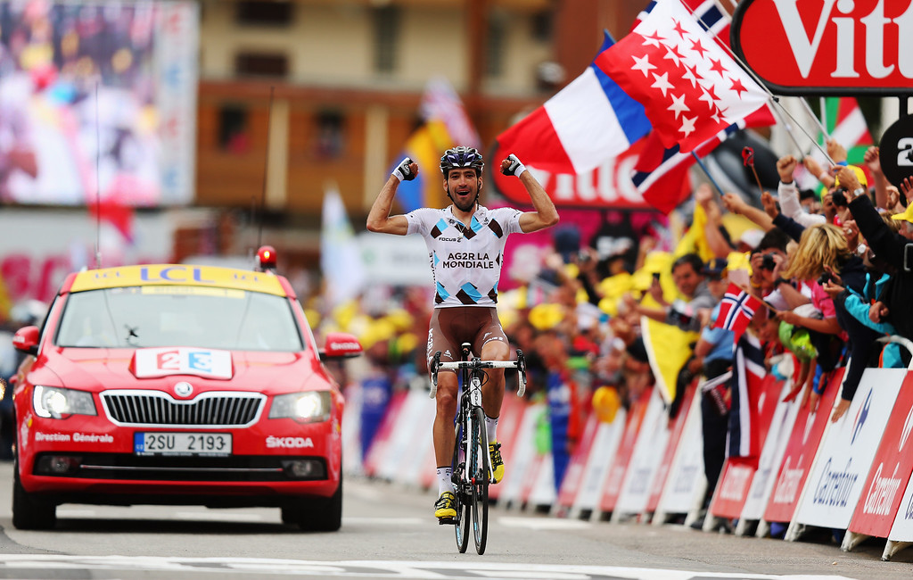 . ALPE D\'HUEZ, FRANCE - JULY 18:  Christophe Riblon of France and Team AG2R La Mondiale reacts as he crosses the finish line to win stage eighteen of the 2013 Tour de France, a 172.5KM road stage from Gap to l\'Alpe d\'Huez, on July 18, 2013 in Alpe d\'Huez, France.  (Photo by Bryn Lennon/Getty Images)