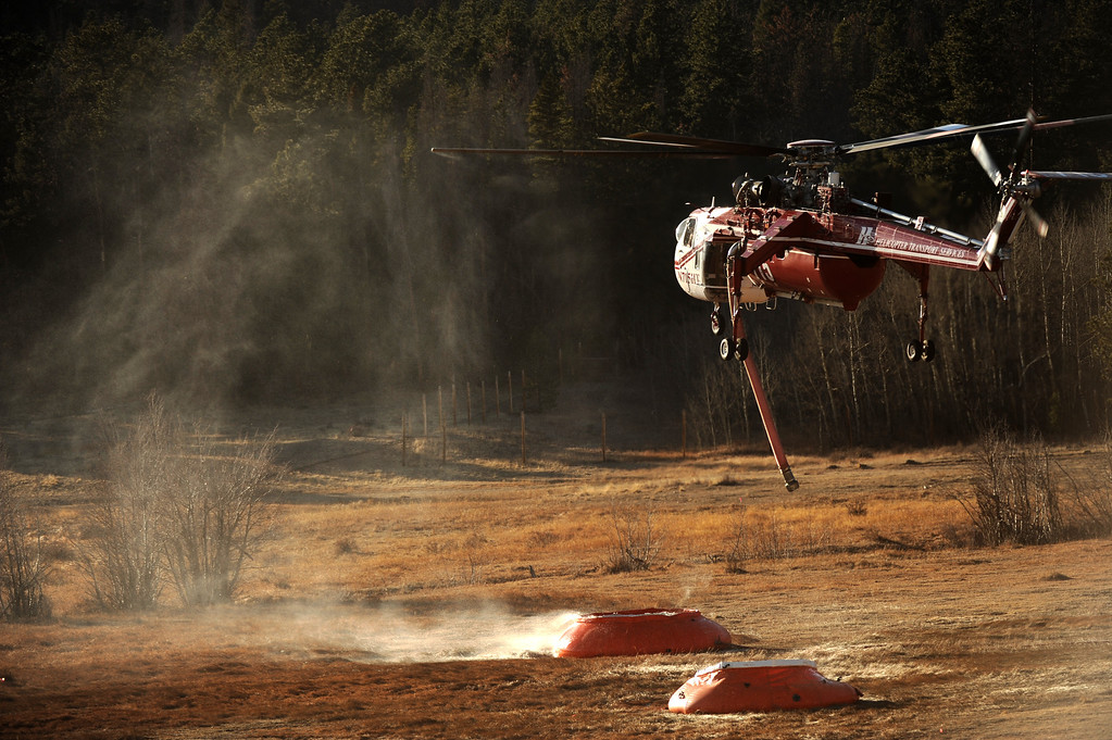 . Helitankers loading up to fight the Fern Lake fire, smoldering at Historic Moraine Park in the  Rocky Mountain National Park, in Colorado Monday, December 3,  2012.    Joe Amon, The Denver Post