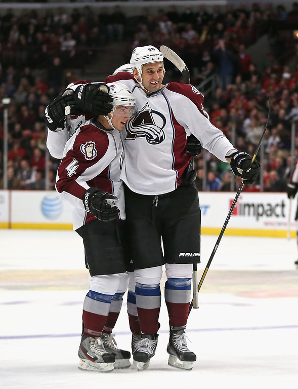 . Tyson Barrie #4 of the Colorado Avalanche (L) gets a hug from teammate Patrick Bordeleau #58 after scoring a first period goal against the Chicago Blackhawks at the United Center on January 14, 2014  in Chicago, Illinois.  (Photo by Jonathan Daniel/Getty Images)