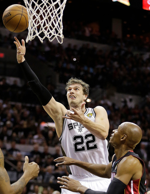 . Tiago Splitter (22), of Brazil, shoots as Miami Heat\'s Ray Allen defends during the first half at Game 5 of the NBA Finals basketball series, Sunday, June 16, 2013, in San Antonio. (AP Photo/Eric Gay)