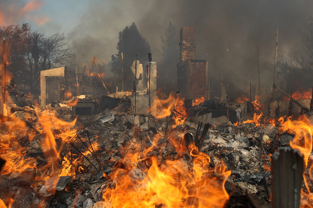. A house burns at the Cocos fire on May 15, 2014 in San Marcos, California. Fire agencies throughout the state are scrambling to prepare for what is expected to be a dangerous year of wildfires in this third year of extreme drought in California.   (Photo by David McNew/Getty Images)