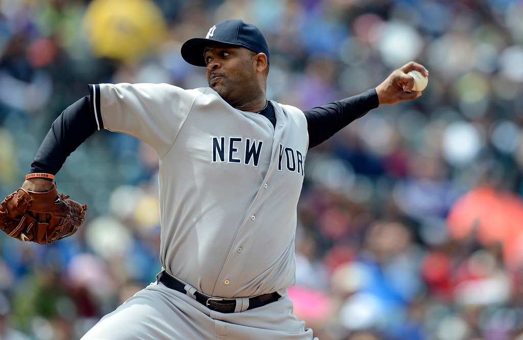 . CC Sabathia (52) of the New York Yankees delivers a pitch during the second against the Colorado Rockies May 9, 2013 at Coors Field. (Photo By John Leyba/The Denver Post)