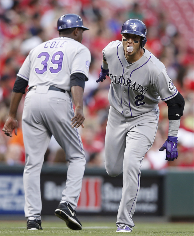 . Troy Tulowitzki #2 of the Colorado Rockies rounds the bases after hitting a two-run home run in the third inning of the game against the Cincinnati Reds at Great American Ball Park on June 5, 2013 in Cincinnati, Ohio. (Photo by Joe Robbins/Getty Images)