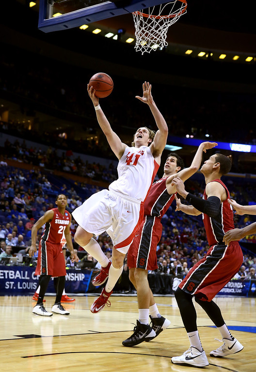 . Cameron Bairstow #41 of the New Mexico Lobos shoots the ball over Dwight Powell #33 of the Stanford Cardinal during the second round of the 2014 NCAA Men\'s Basketball Tournament at Scottrade Center on March 21, 2014 in St Louis, Missouri.  (Photo by Andy Lyons/Getty Images)