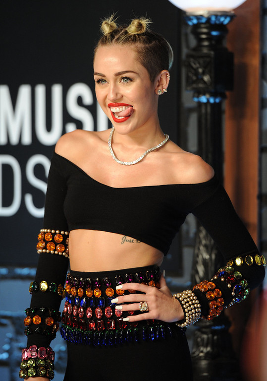 . Miley Cyrus arrives at the MTV Video Music Awards on Sunday, Aug. 25, 2013, at the Barclays Center in the Brooklyn borough of New York. (Photo by Evan Agostini/Invision/AP)